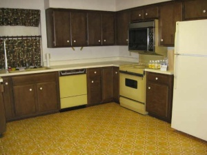 Again dark cabinets, harvest gold, and lots of harvest gold vinyl floors!