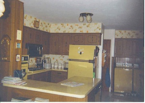 Diggin' this one. It has wallpaper, and Tupperware, bonus a matching washer and dryer. Plus that lovely light fixture.